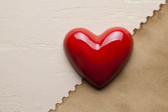 Red heart and paper sheet Royalty Free Stock Photography