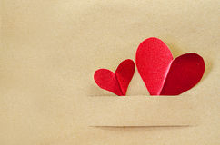 Red heart on paper. Red heart on vintage brown paper background with copyspace Stock Photography