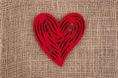 Red heart side by side on the burlap. royalty free stock photos