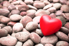 Red heart on pebble stones Stock Images