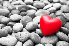 Red heart on pebble stones Royalty Free Stock Image
