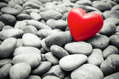 Red heart on pebble stones Stock Photo