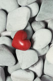 Red heart on pebble stones, still life. Valentines day and lovers background Royalty Free Stock Images