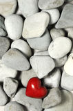 Red heart on pebble stones, still life. Valentines day and lovers background. Red clear plastic heart on pebble stones, still life. Valentines day and lovers Royalty Free Stock Photos