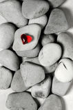 Red heart on pebble stones, still life. Valentines day and lovers background. Red clear plastic heart on pebble stones, still life. Valentines day and lovers Stock Photography