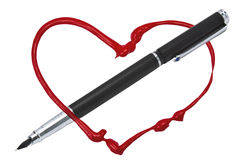 Red heart and a pen Stock Image