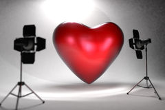 Red heart in photo studio Royalty Free Stock Photos