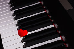 Red heart on piano keyboard Royalty Free Stock Photography