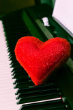 Red heart on piano keyboard Royalty Free Stock Images