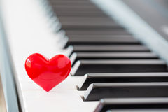 Red heart on piano
