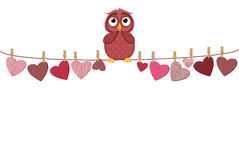 A red heart with a picture hanging on a rope. Cute owl sitting Stock Images