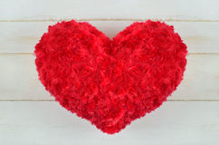 Red heart pillow with rose pattern Royalty Free Stock Photo