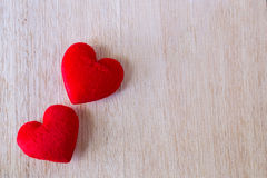 red heart pillow shape on wood Stock Photography