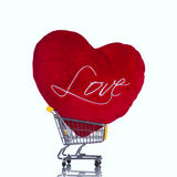 Red heart pillow in a shopping cart Royalty Free Stock Photo