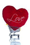Red heart pillow in a shopping cart Royalty Free Stock Images