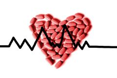 Red heart pills. Red heart made with pills Stock Photo