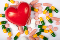 Red heart and pills Stock Photo