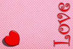 The red heart on a pink background, a Valentine's Day. Royalty Free Stock Photography
