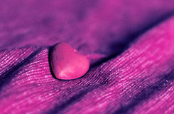 Red heart on pink canvas Royalty Free Stock Image
