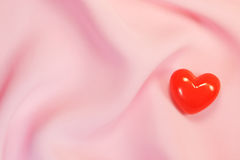 Red heart on pink fabric Royalty Free Stock Photography