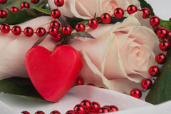 Red heart and pink roses Stock Photos