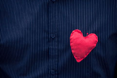 Red heart pinned male breast Stock Image