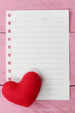 Red heart placed on paper note of empty for input text or messag Royalty Free Stock Photos
