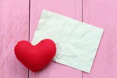 Red heart placed on paper note of empty for input text or messag Stock Photo