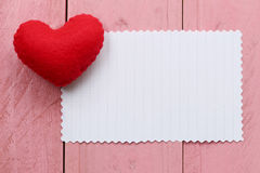 Red heart placed on paper note of empty for input text or messag Royalty Free Stock Photography