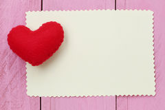 Red heart placed on paper note of empty for input text or messag Royalty Free Stock Photo