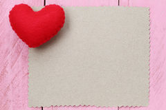 Red heart placed on paper note of empty for input text or messag Royalty Free Stock Image