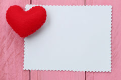 Red heart placed on paper note of empty for input text or messag Stock Photos