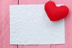 Red heart placed on paper note of empty for input text or messag Stock Image