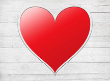 Red heart placed on a white wooden wall, planks Royalty Free Stock Images