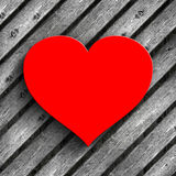 Red heart on planks background Stock Images