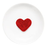 Red heart on a plate Royalty Free Stock Images