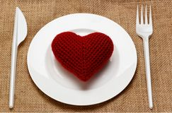 Red heart in plate with knife and fork Stock Images