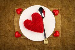 Red heart on the plate royalty free stock image