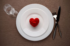 Red heart on a plate for romantic date on Valentines day. Stock Image
