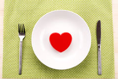Red heart on plate Stock Image