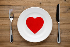 Red heart on plate Stock Images
