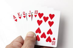 Red heart playing cards straight flush in hand Royalty Free Stock Image