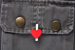 Red heart on pocket. Royalty Free Stock Photography