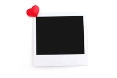 Red heart and polaroid photo Stock Photos