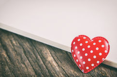 Red heart with polka dot pattern and blank paper with vintage to Stock Image