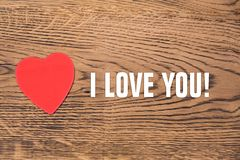 Red heart post-it and the text `I love you` on a wooden background stock image