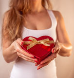 Red heart present woman hands holding - Valentine surprise Royalty Free Stock Image