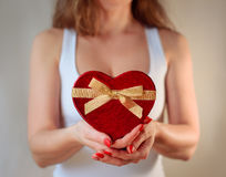 Red heart present woman hands holding - Valentine surprise stock photo