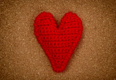 Red heart on pressured cork background. Love heart on pressured cork texture background, valentines day card concept Royalty Free Stock Photo
