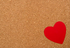 Red heart on pressured cork background Royalty Free Stock Photo
